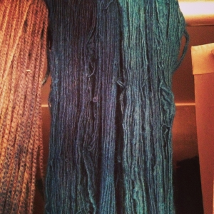 Shireen's navy blue and Leslie's forest green fingering weight skeins