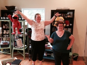 Jenn (with Kim, right) holds the Elmo and Minion pinatas, moments before their untimely end!